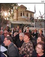 Greek Cypriot pilgrims cross the border to visit a church in the Turkish area