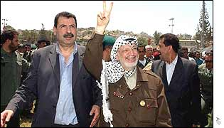 Arafat waves to supporters in Jenin town