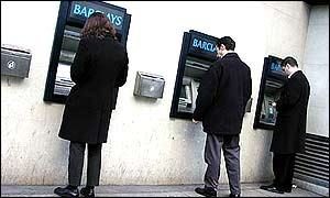 Customers at Barclays cash machines