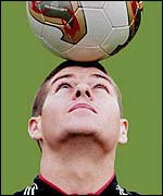 Steven Gerrard balances a football on his forehead