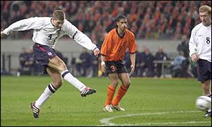 Steven Gerrard shoots against Holland