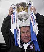 Peter Taylor celebrates Brighton's Divison Two title at the Withdean Stadium
