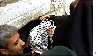 Yasser Arafat emerges from the Church of the Nativity