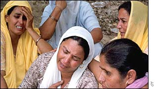 Women weep for family members killed in the attack near Jammu