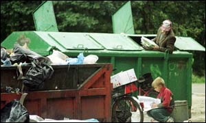 Man picking through rubbish in Poland