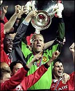 Peter Schmeichel lifts the Champions League trophy for Manchester United in 1999