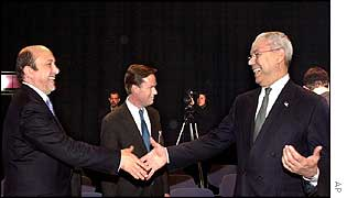 Russian Foreign Minister Igor Ivanov (left) shakes hands with US Secretary of State Colin Powell