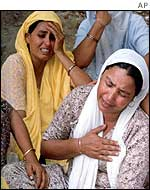 Women grieves over the killings at the camp