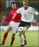 Ryan Giggs puts Germany's Jorg Heinrich under pressure