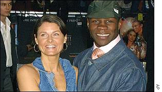 Former boxing champ Chris Eubank arrived with his wife