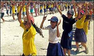 East Timorese students dance during a rehearsal for the independence party in Dili, East Timor