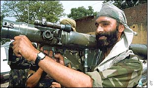 Indian Army soldier demonstrates rocket launcher used against suspected Islamic militants in Kaluchak