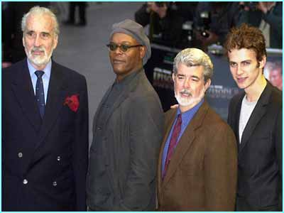 Stars of the film including film maker George Lucas posed in their swish suits before the premiere