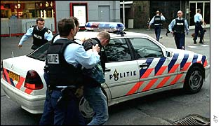 Police arrest an unidentified suspect outside the Media Center in Hilversum, Netherlandsap