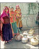 Women gather at a village well