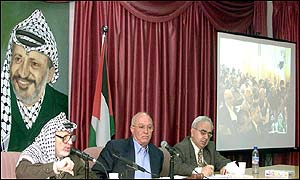 Yasser Arafat (left) addresses assembly