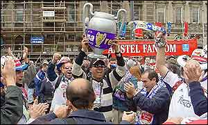 Real fans in George Square with replica trophy