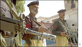 Pakistani policemen guard the special court in Hyderabad