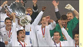 Real Madrid captain Fernando Hierro raises the trophy after his team beat Bayer Leverkusen