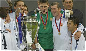 Real Madrid players wait to lift the European Cup