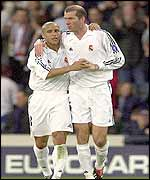 Roberto Carlos (left) and Zinedine Zidane celebrate Real Madrid's winning goal