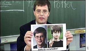 Balkenende holds up a picture of himself and schoolboy wizard Harry Potter