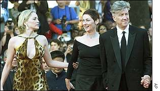 Sharon Stone is on the jury headed by David Lynch, who arrived with his wife (centre)