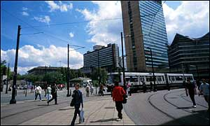 Trams are just one of many travel options around Manchester