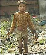 Boy scavenging for bottles at a Dhaka rubbish tip