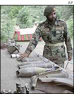 Pakistani colonel shows what he says are Indian artillery shells fired across the LOC