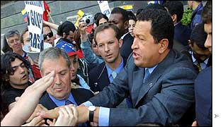 Hugo Chavez is mobbed by supporters outside his hotel in Madrid