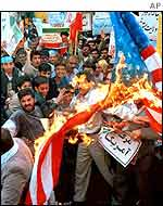 Protesters burn a US flag in Tehran