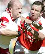 Tyrone captain Peter Canavan (left) comes up against Enda McNulty