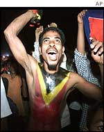 Man with East Timorese flag painted on his chest