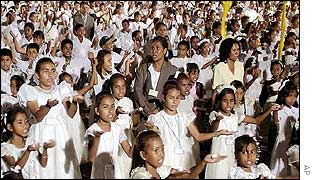 East Timorese children hold candles at celebrations