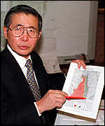 [ image: President Alberto Fujimori points out the jungle territory]
