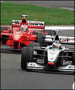 [ image: Arch rivals Hakkinen and Schumacher nose-to-tail at Luxembourg]