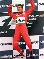 [ image: Leap of joy - Schumacher at Monza, his win brought him back into the chase]