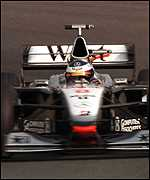 [ image: Hakkinen pushes on in his McLaren]