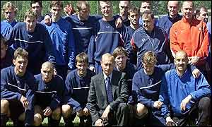 Vladimir Putin poses with the Russian national squad