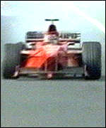 [ image: Blown out: Michael Schumacher exits the Japanese Grand Prix]