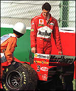 [ image: Devastated: Schumacher inspects the damage]