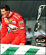 [ image: The pits: Schumacher sits out the race]
