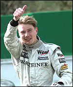 [ image: Thumbs up for winner Hakkinen]