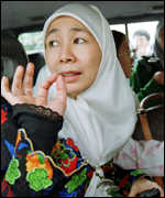 [ image: Wan Azizah, Mr Anwar's wife, has been regularly attending court]