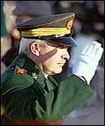 [ image: An Irish army officer salutes during the ceremony]