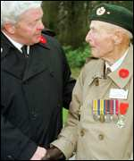 [ image: A veteran shakes hands with Canada's Veterans Affairs Minister Fred Mifflin]