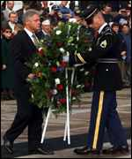 [ image: President Clinton lays a wreath at Washington's Arlington cemetery to commemorate the 116,000 US dead]