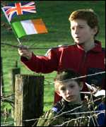 [ image: Two boys wave British and Irish flags at Messines Ridge]