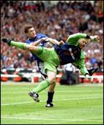 [ image: Flying Dane: Schmeichel's arrival at Old Trafford heralded the success of the nineties]